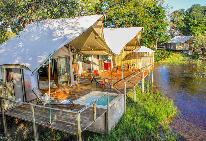 View of private deck and plunge pool of tented chalet at Zambezi Sands on river bank