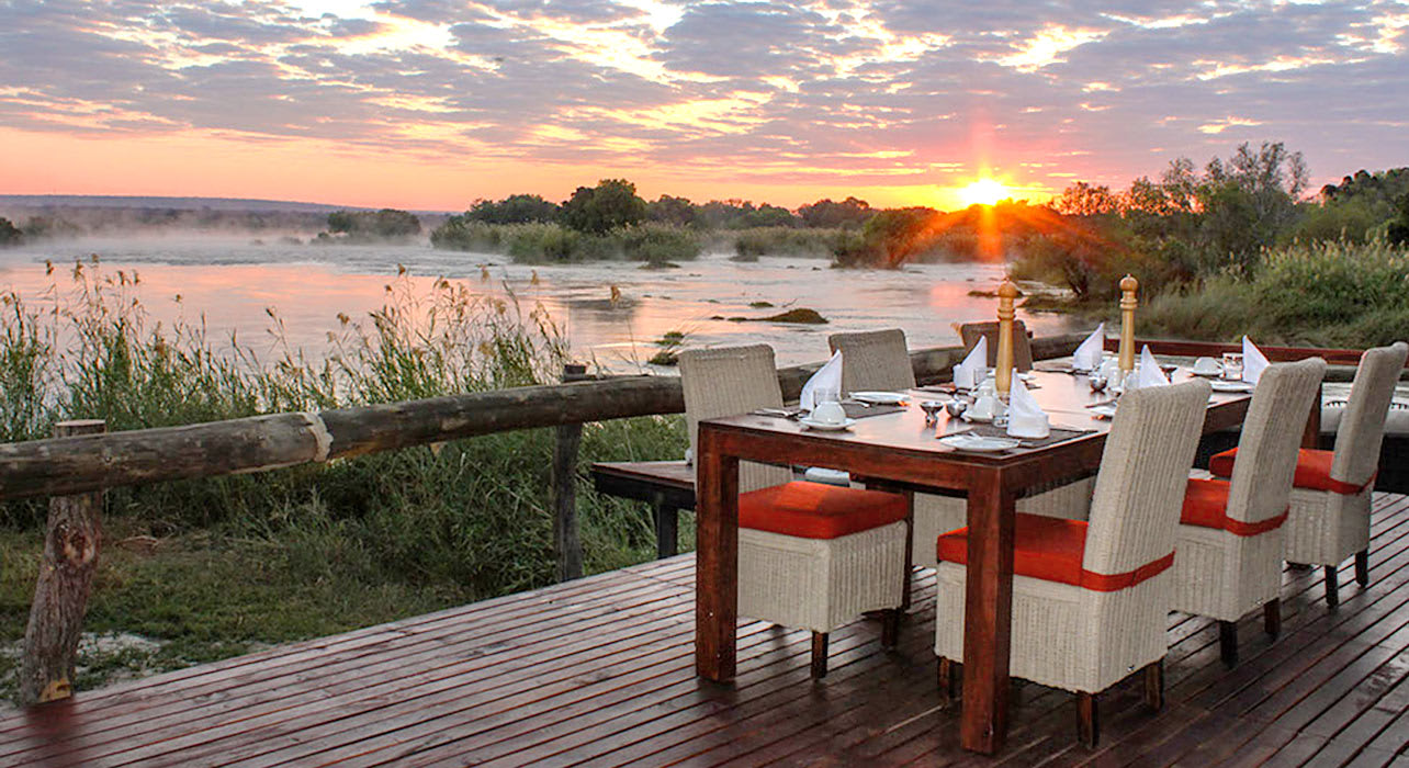 3 slide zambezi sands breakfast table sunrise africa safari pano