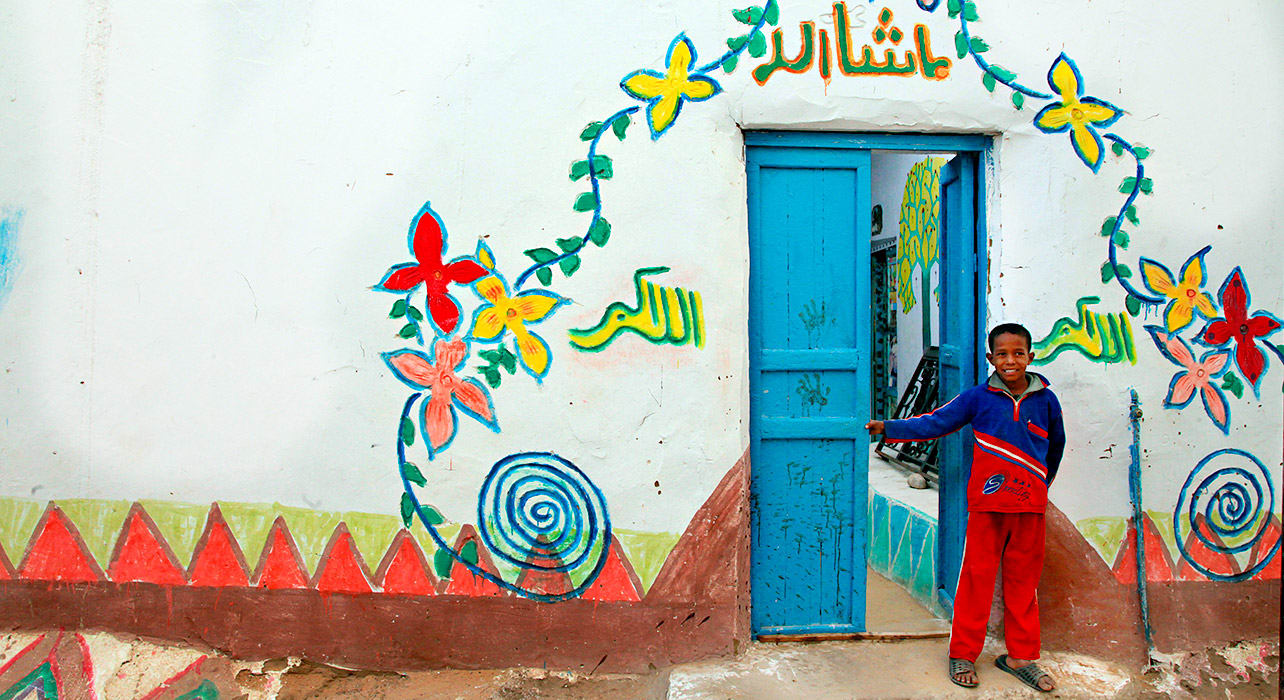 egypt smiling boy n blue door n painting