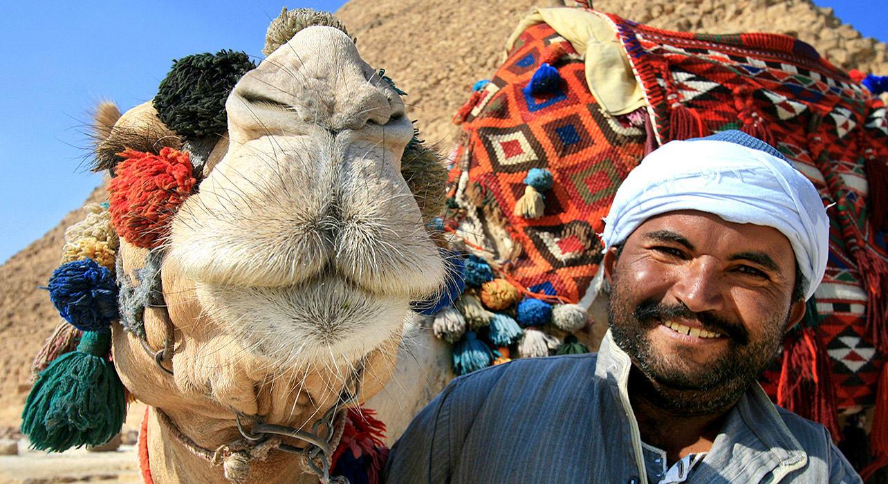 giza pyramids camel man tourist