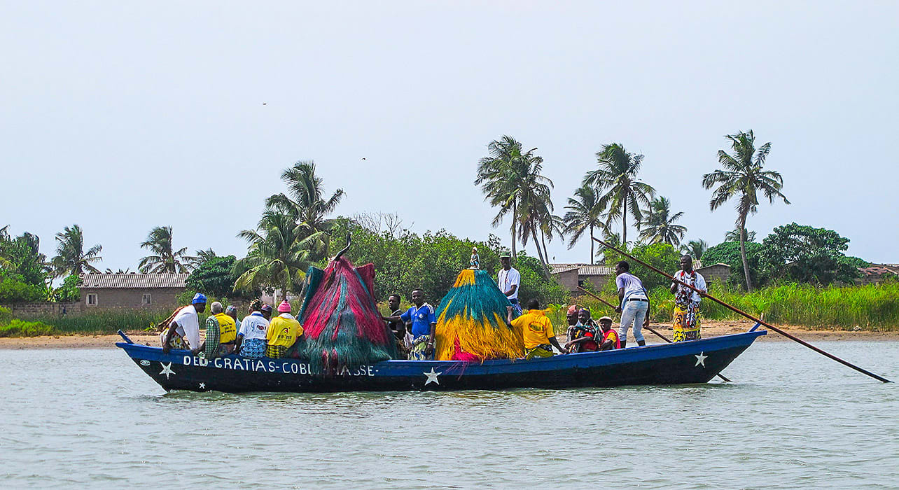 ghana togo benin boat men palm trees