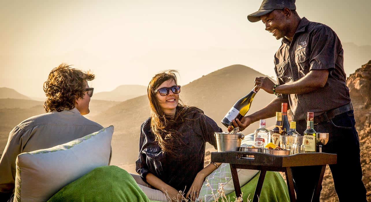 7 slide huab under canvas sundown drinks namibia pano