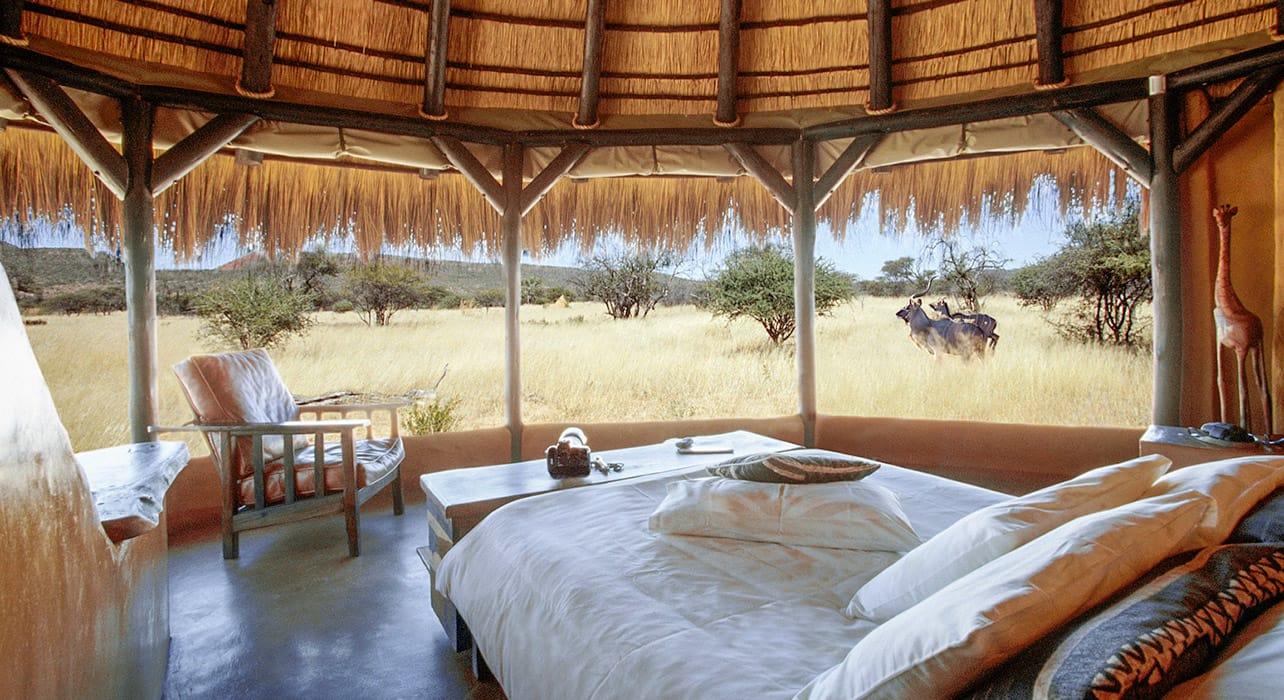 4 slide okonjima namibia bush camp bedroom pano