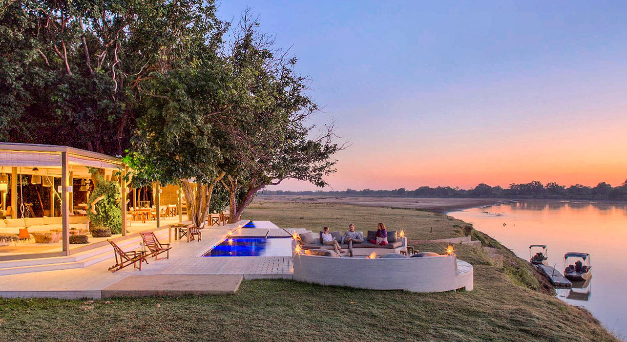 chinzombo camp dusk luxury river