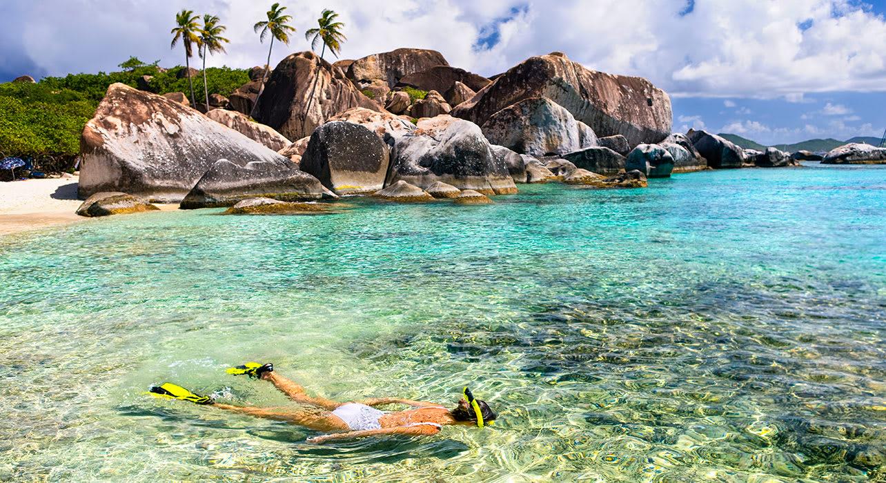 woman snorkeling seychelle islands
