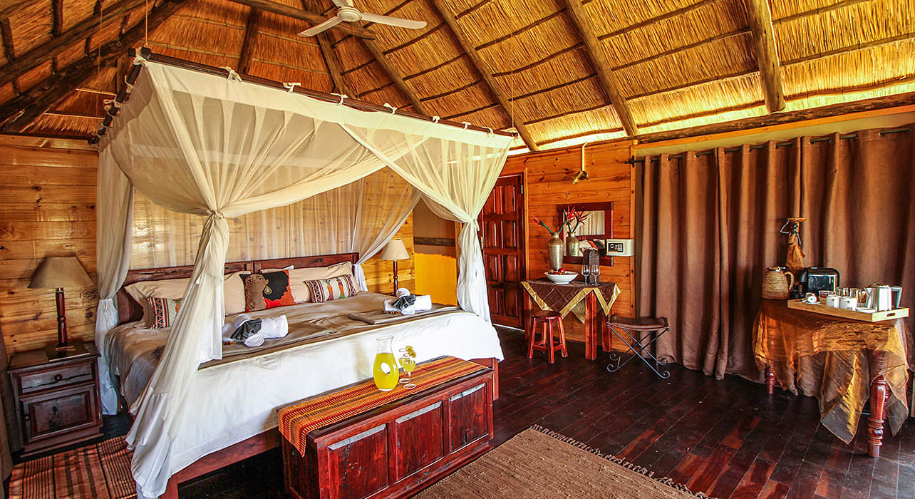 zimbabwe room interior canopy bed thatched roof