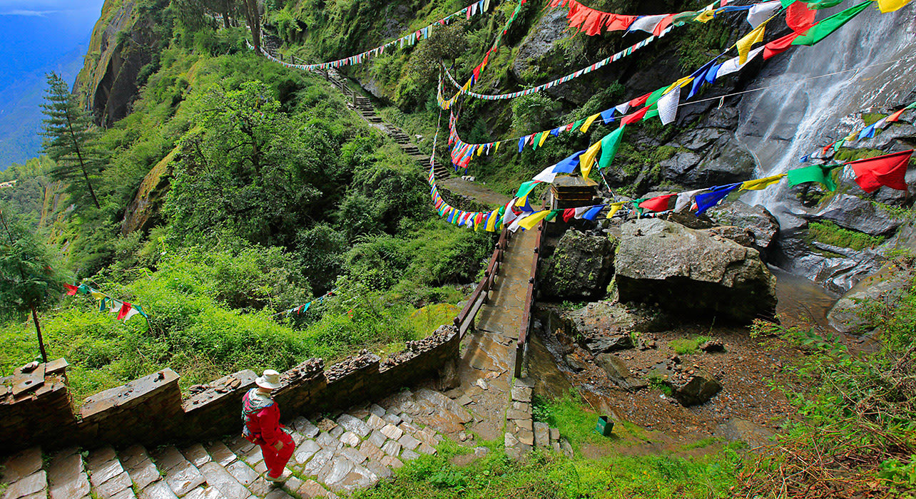 1 slide bhutan trek forest path prayer flags pano