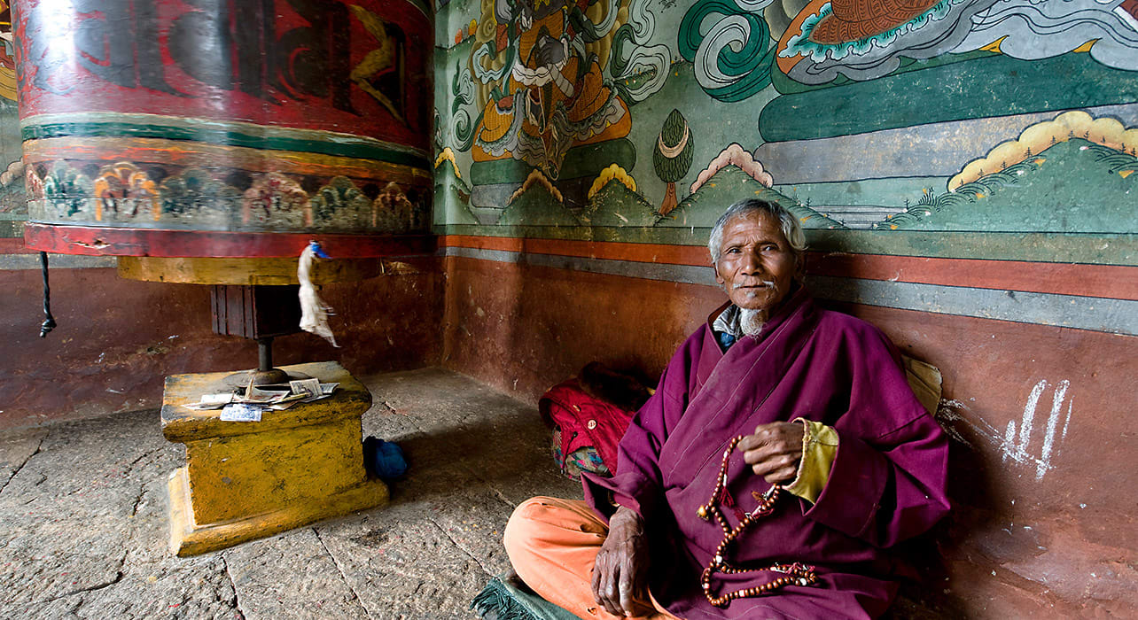 bhutan monk pray wheel