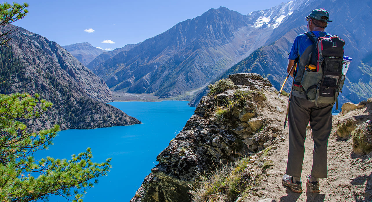 hiker lake dolpo nepal