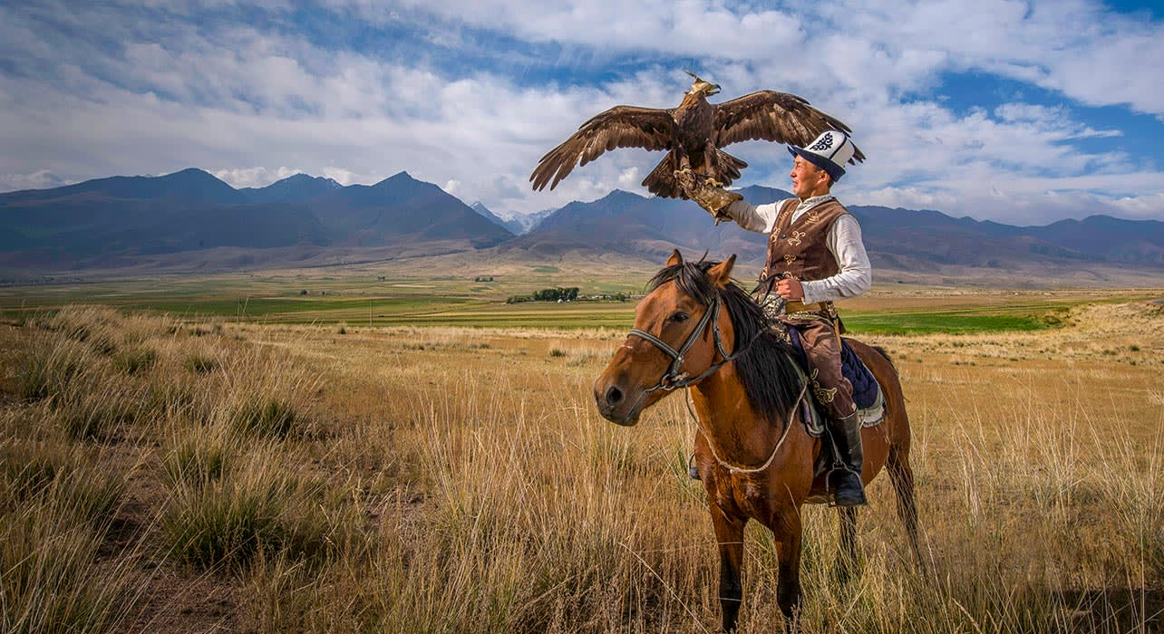 2 slide kyrgyzstan eagle hunter kazak pano