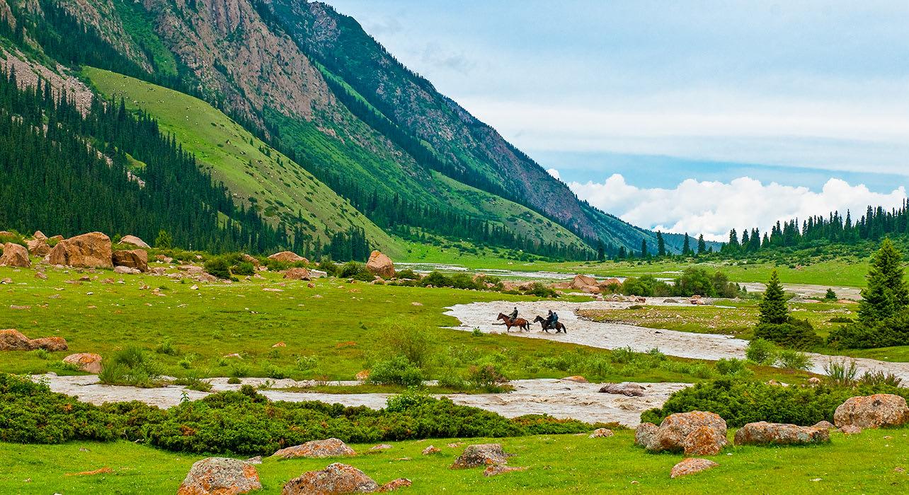9 slide kyrgyzstan valley horsemen river pano