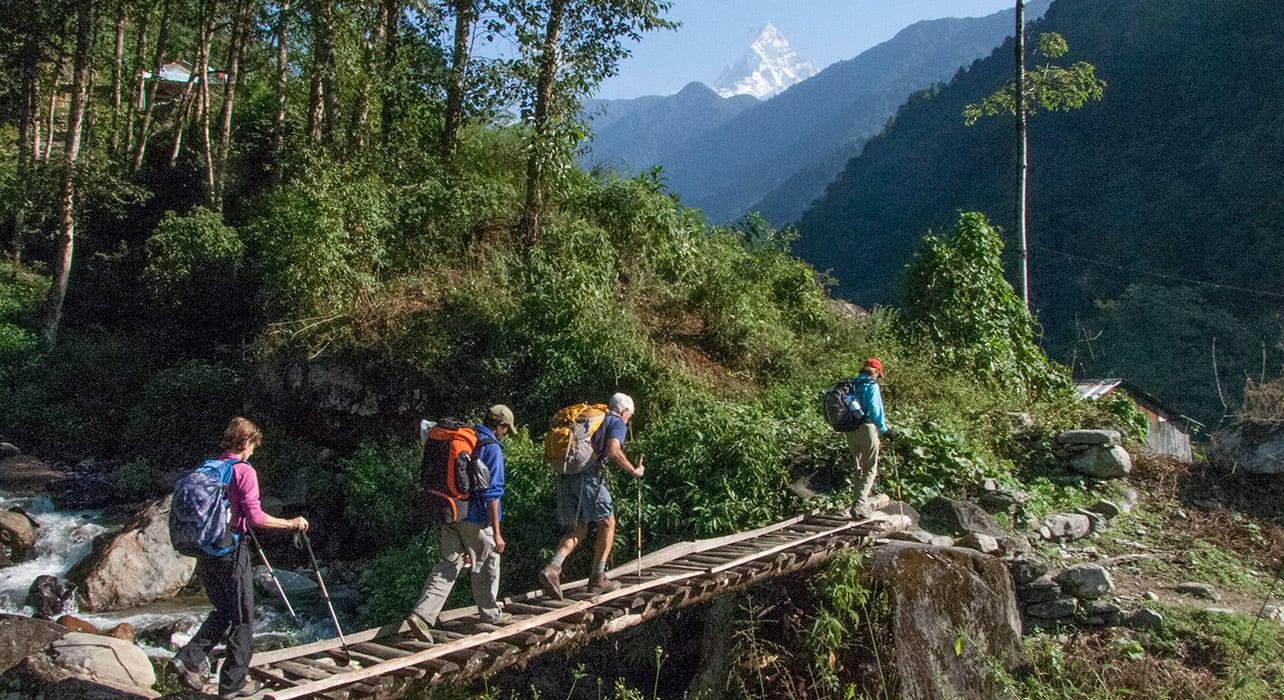 trek group bridge nepal annapurna