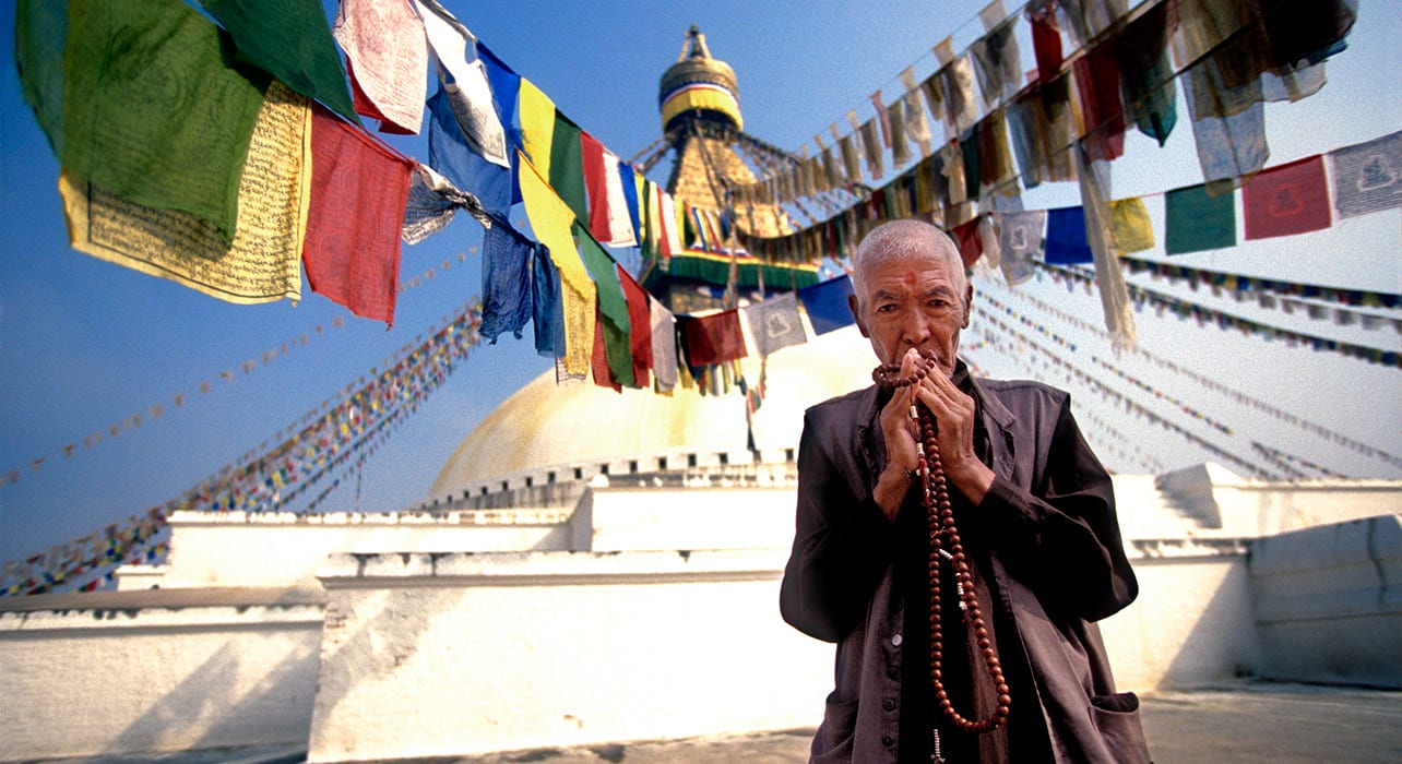 nepal kathmandu prayer flags man