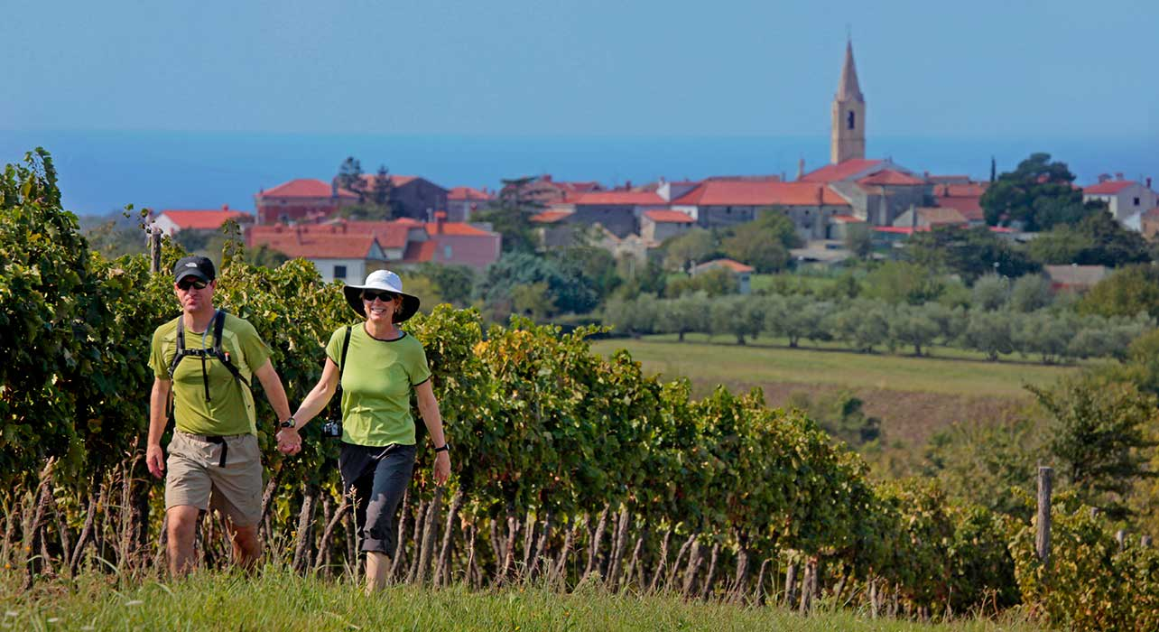 croatia church hike couple by vineyards