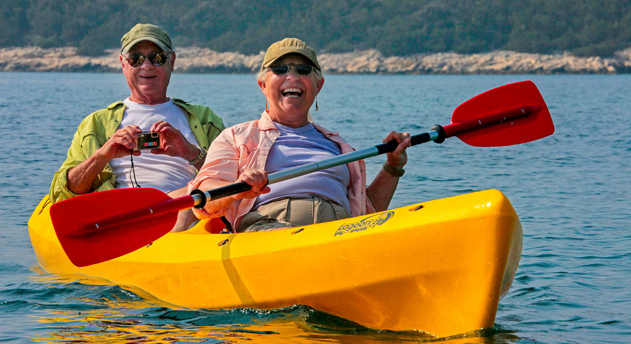 croatia happy couple kayaking