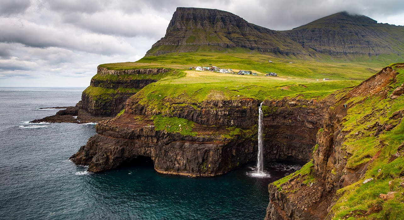 faroe islands denmark waterfall coastline