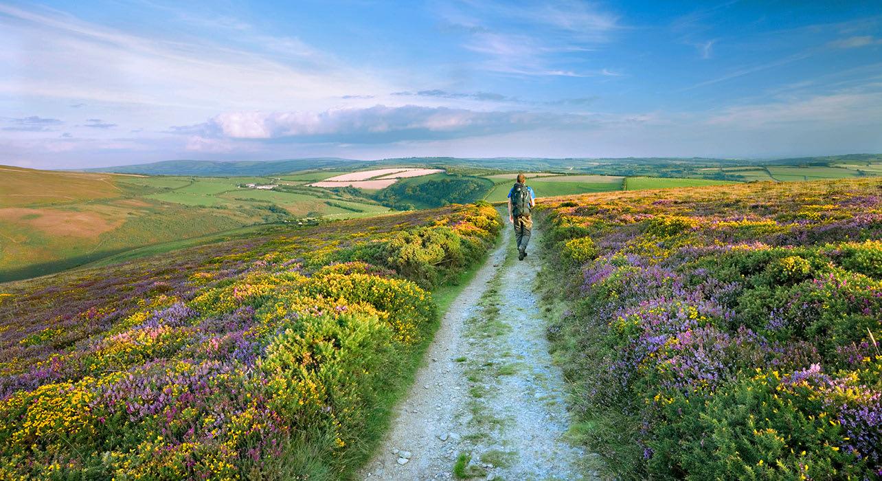 2 slide england hiker moors spring pano