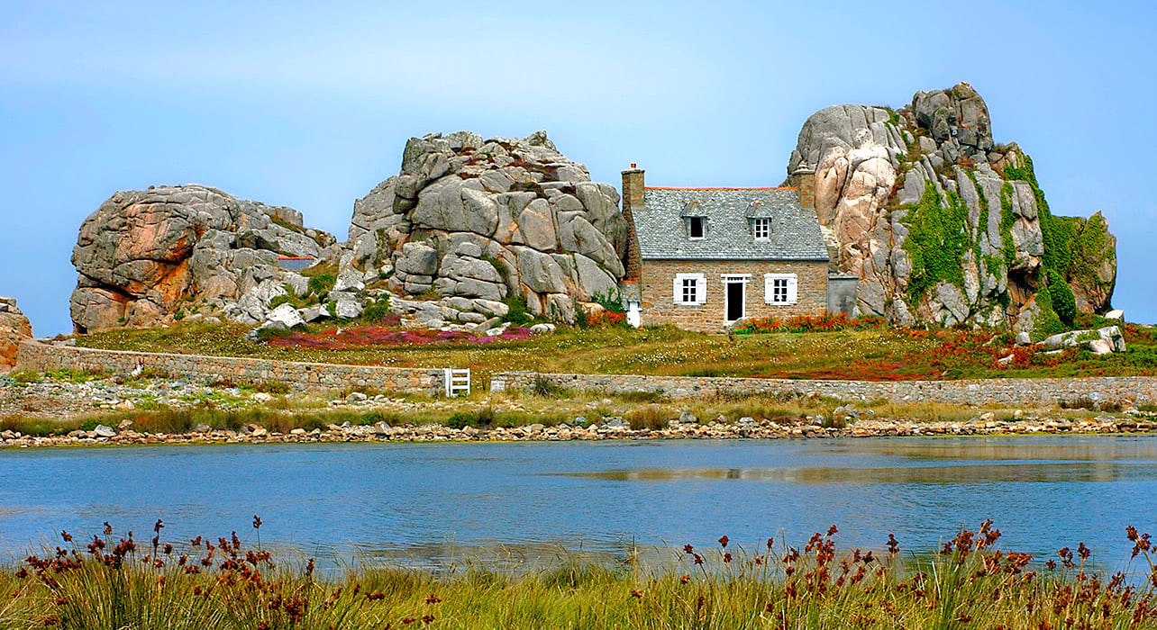 normandy and brittany cottage rock face