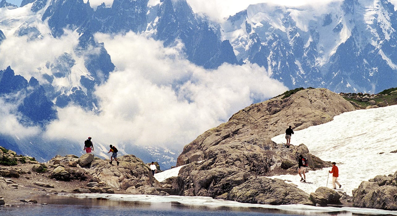 mt blanc switzerland hikers snowy lake