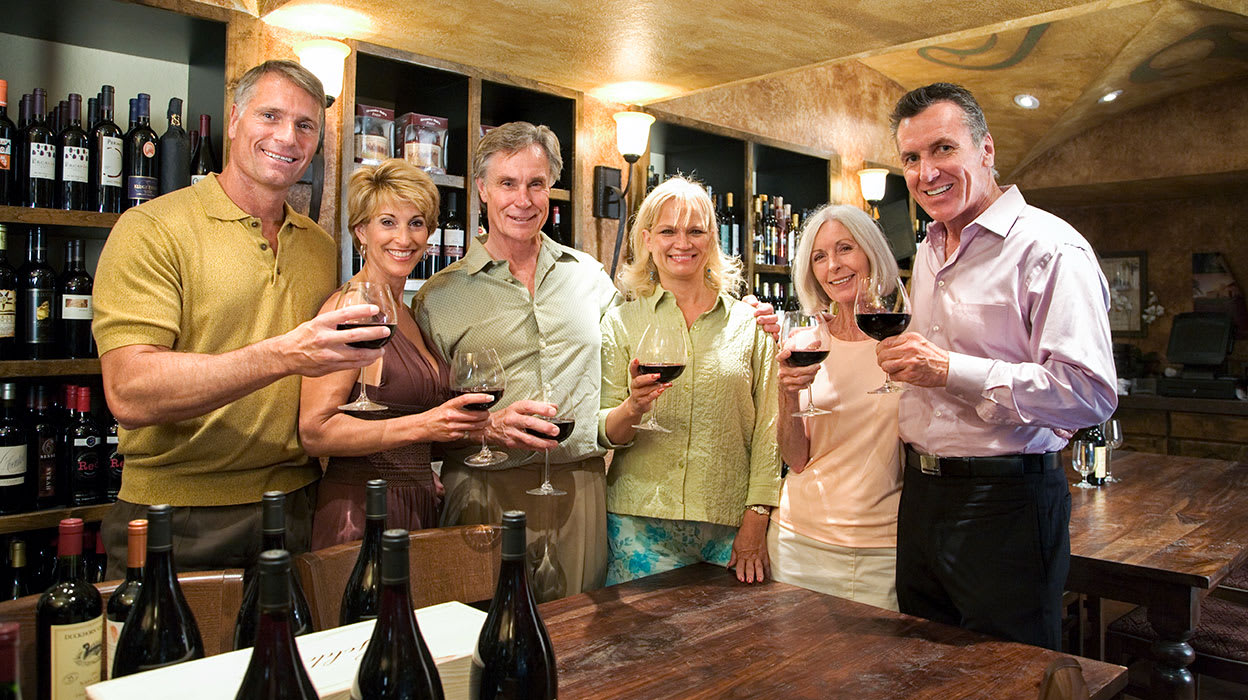 mature adults wine tasting wine cellar
