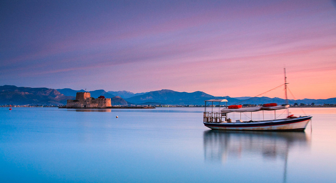 greece nafplio sunset boat on calm water