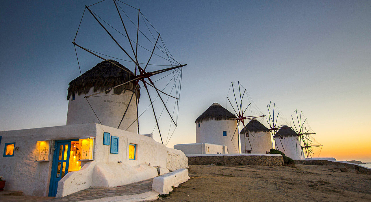 greece mykonos windmills evening