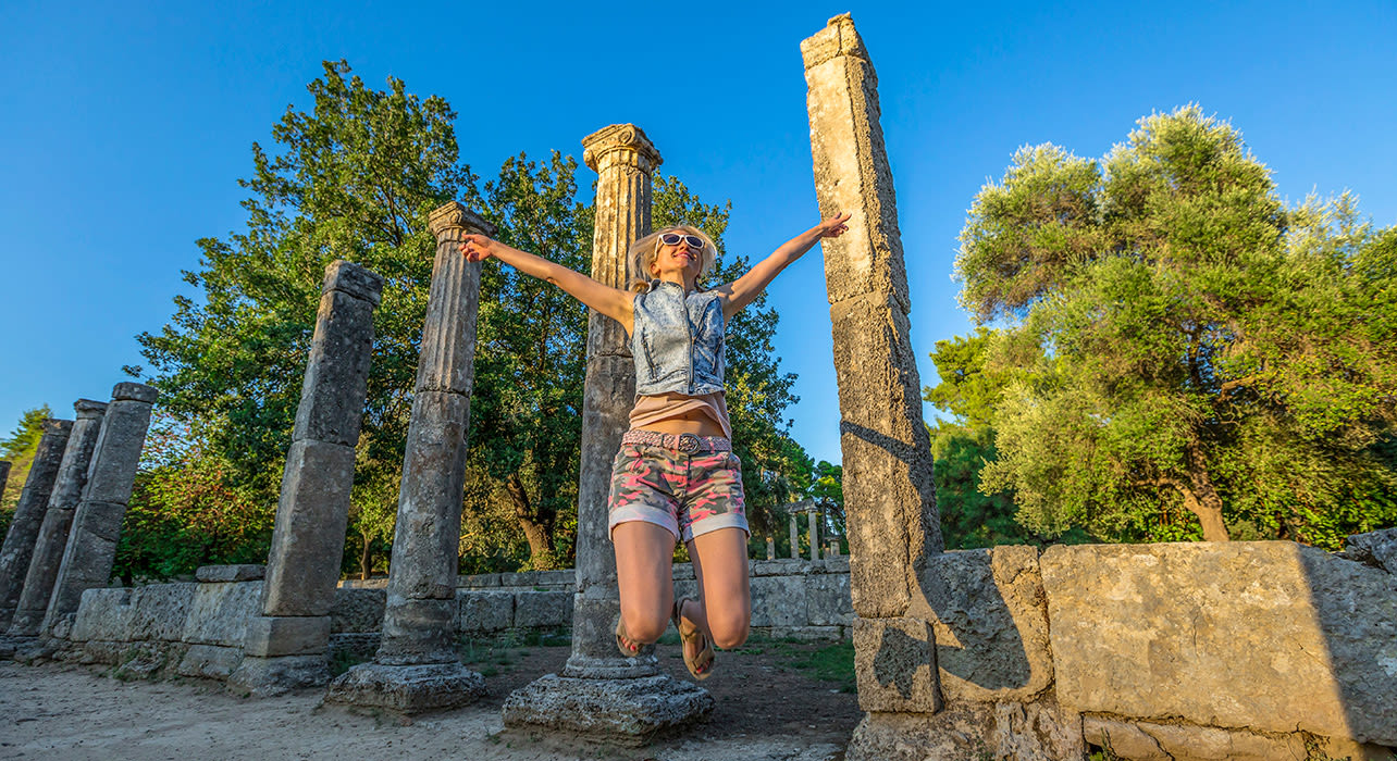 greece olympia ruins happy woman
