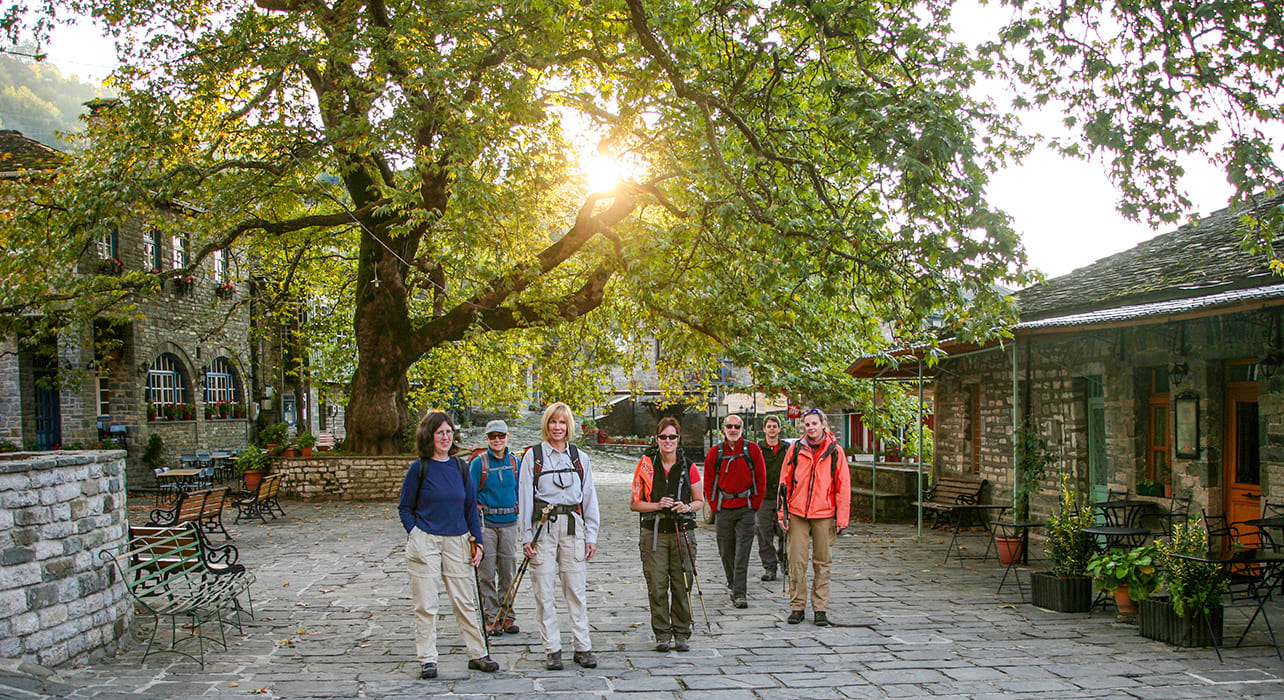 greece zagoria hikers in town