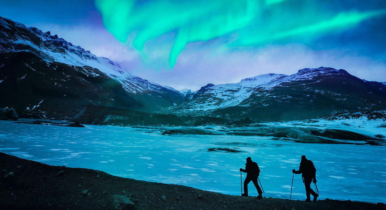 iceland hikers northern lights aurora borealis
