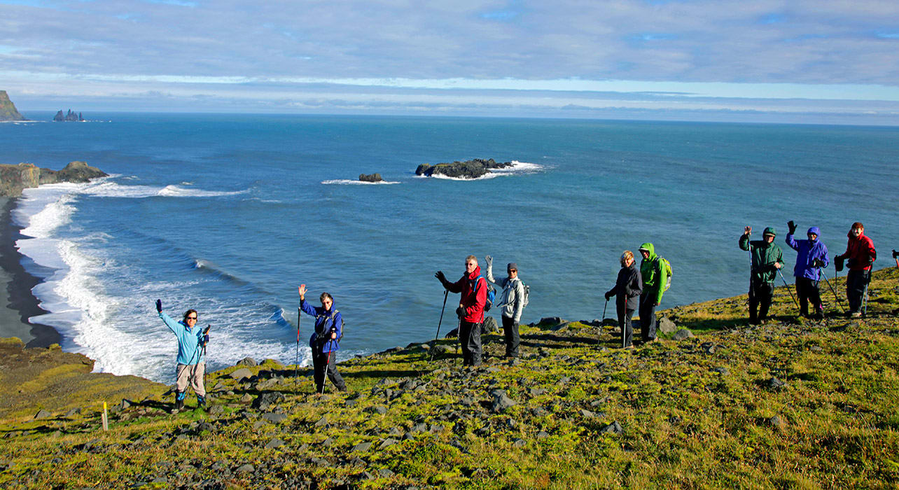 iceland group hiking by ocean