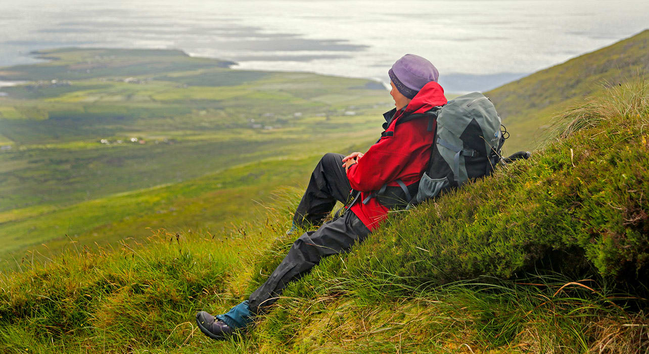 ireland mt dingle hiker relaxing