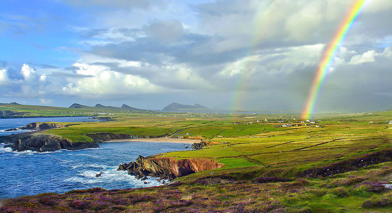 ireland shoreline cliffs beach rainbow