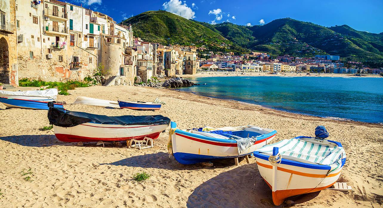 4 slide boat cefalu sicily italy pano