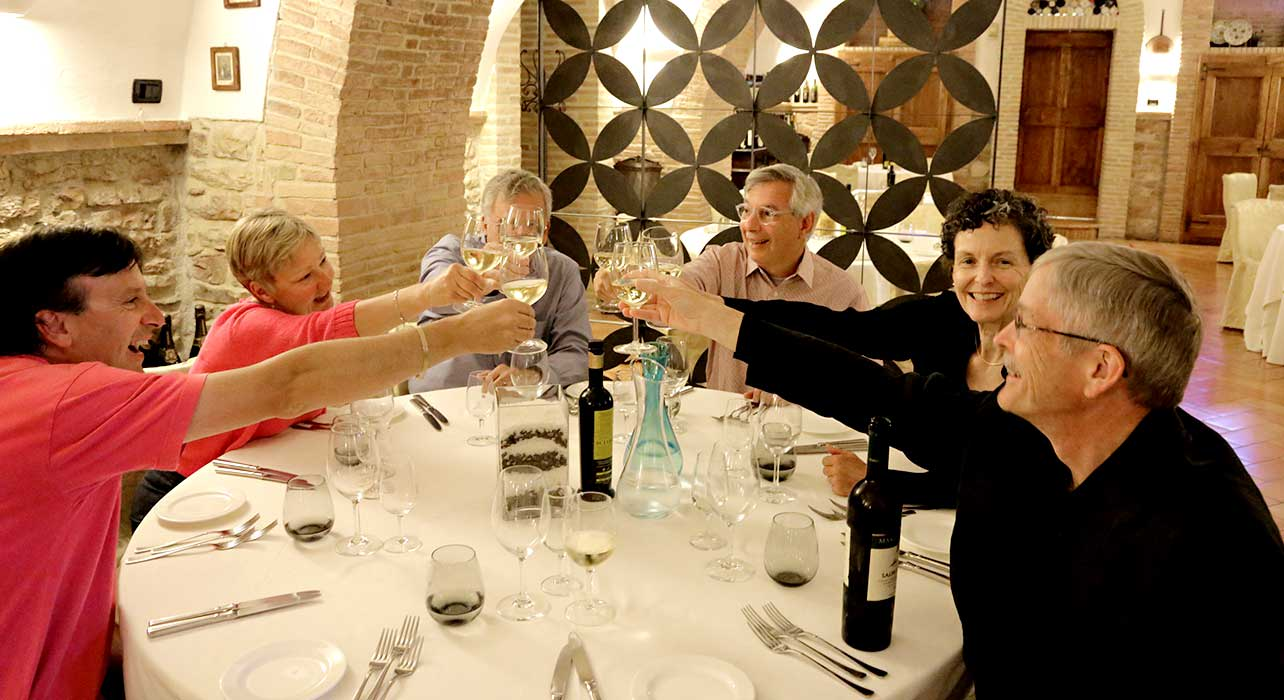 wine restaurant happy clients toast italy