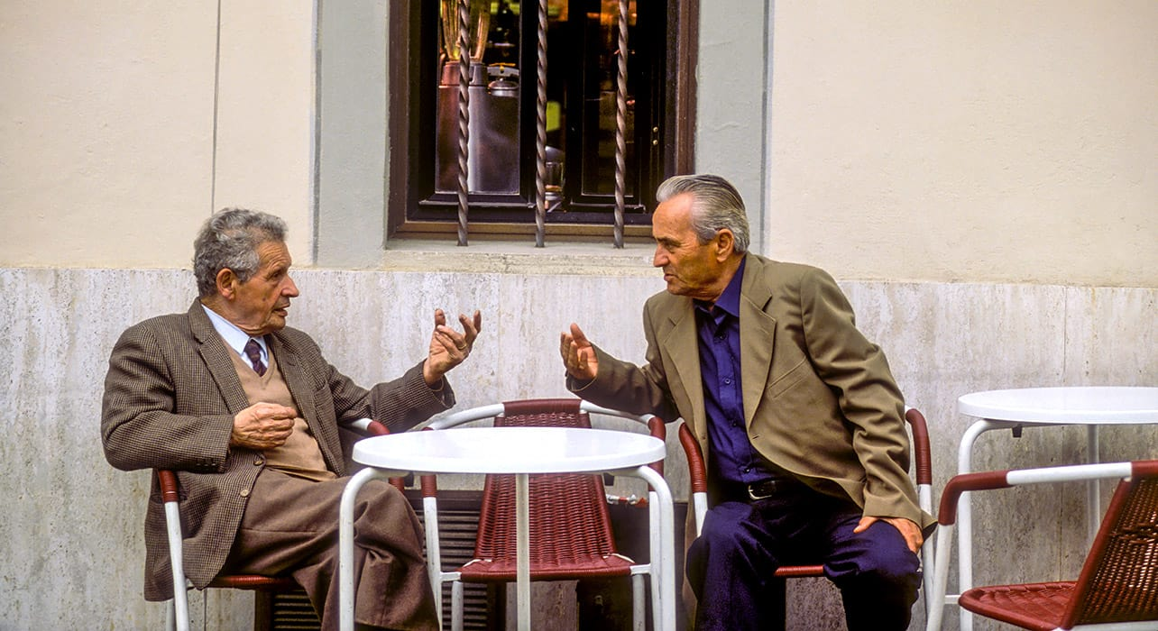 tuscany two men talking