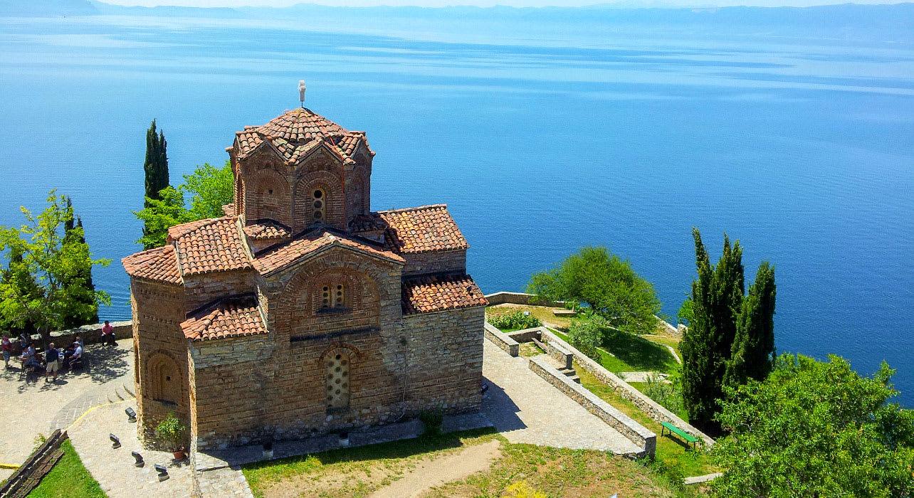 macedonia church on cliff overlooking blue ocean