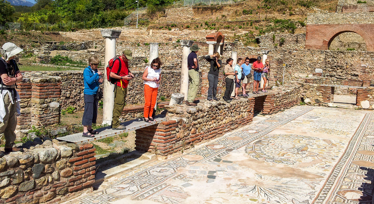 macedonia hikers viewing ancient remains tiles tourists