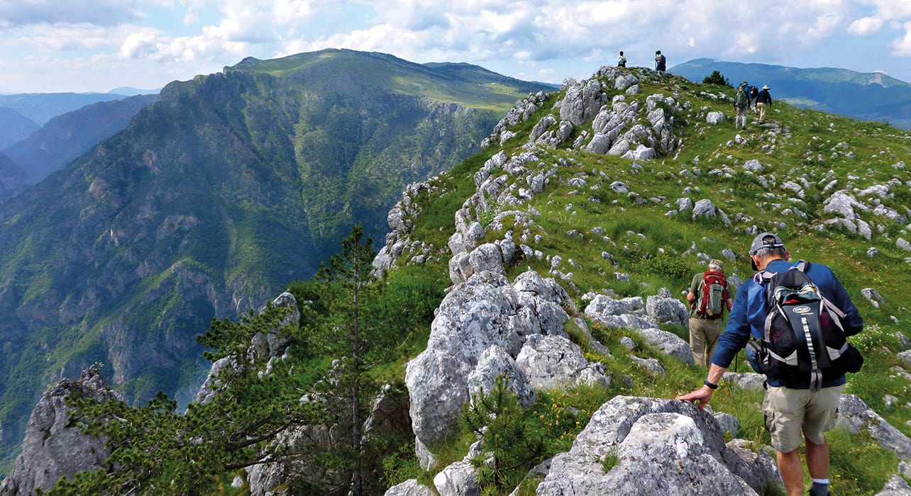 montenegro hikers mountain top view