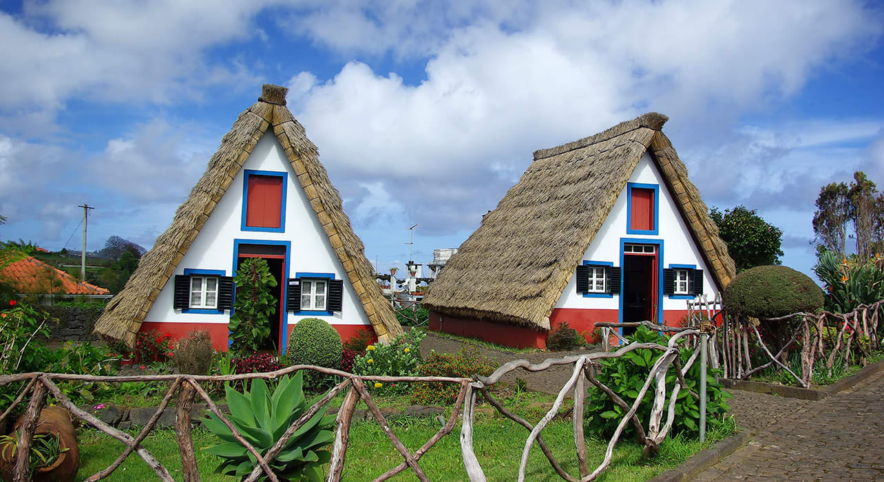 5 slide portugal thatched roof houses pano
