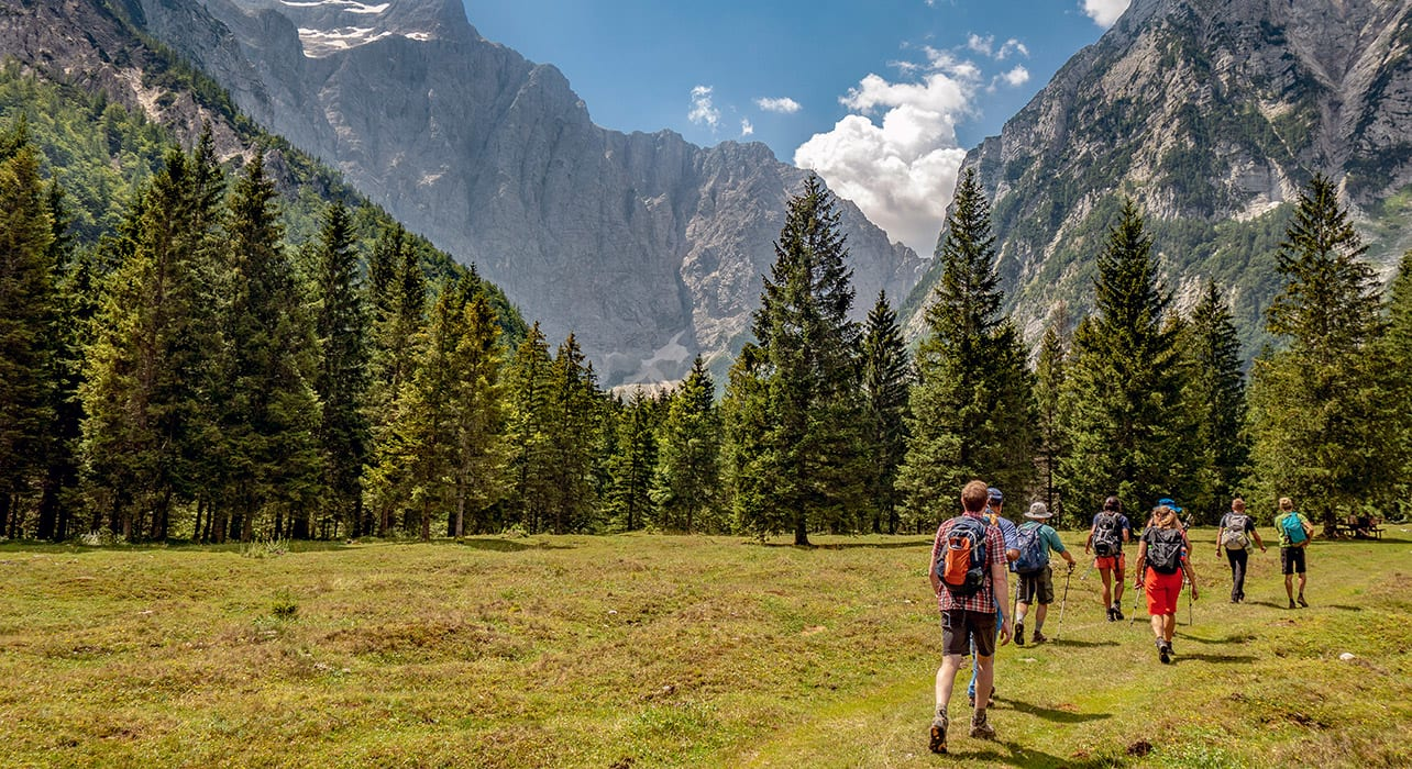 hikers in slovenia valleys mountains