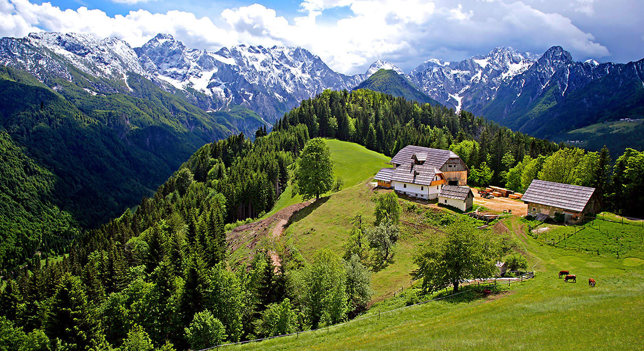 slovenia mountain snowy peaks charming cottages