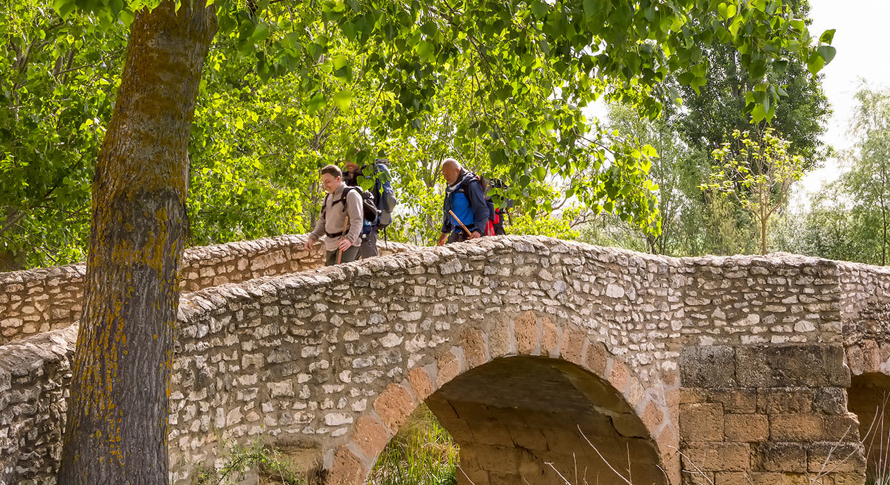 spain pilgrim hike stone bridge
