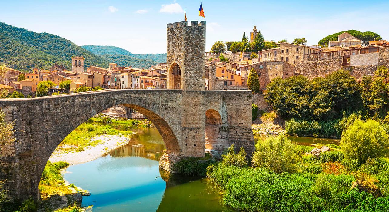 medieval bridge with antique gate besalu spain castle