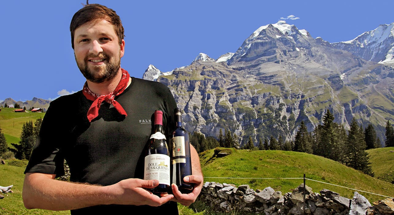 switzerland man with wine by mtns