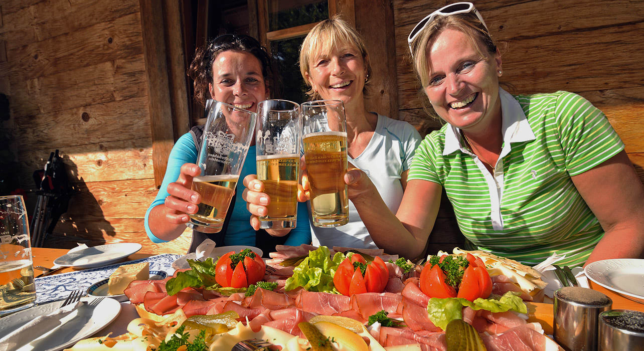 women hikers enjoying beer and food