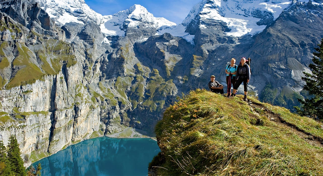 switzerland kandersteg alpine lake hikers