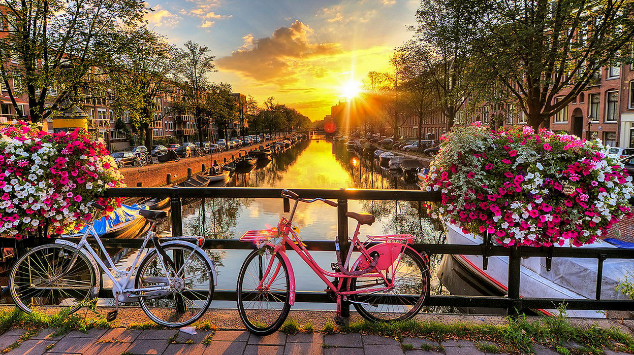 rhine river netherlands amsterdam canals at sunrise bikes