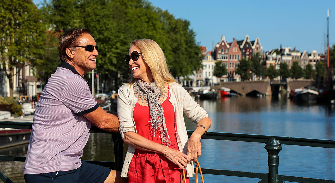netherlands amsterdam canal couple smiling