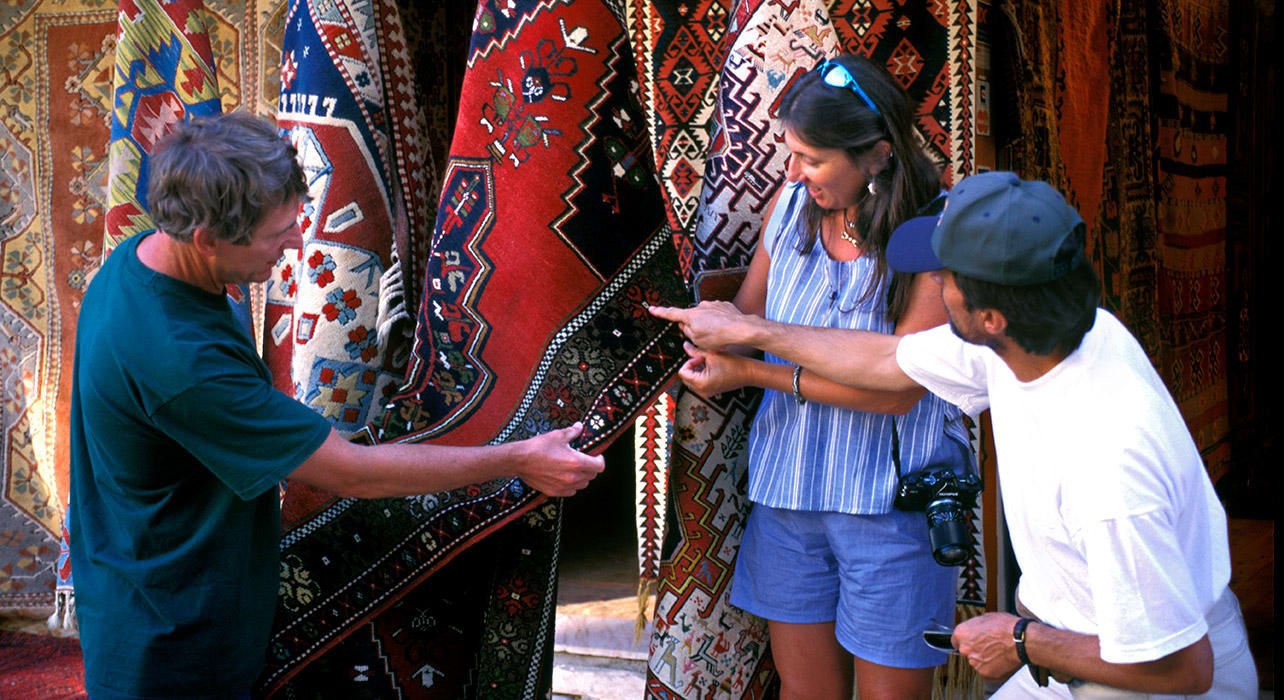 turkey couple looking at rugs
