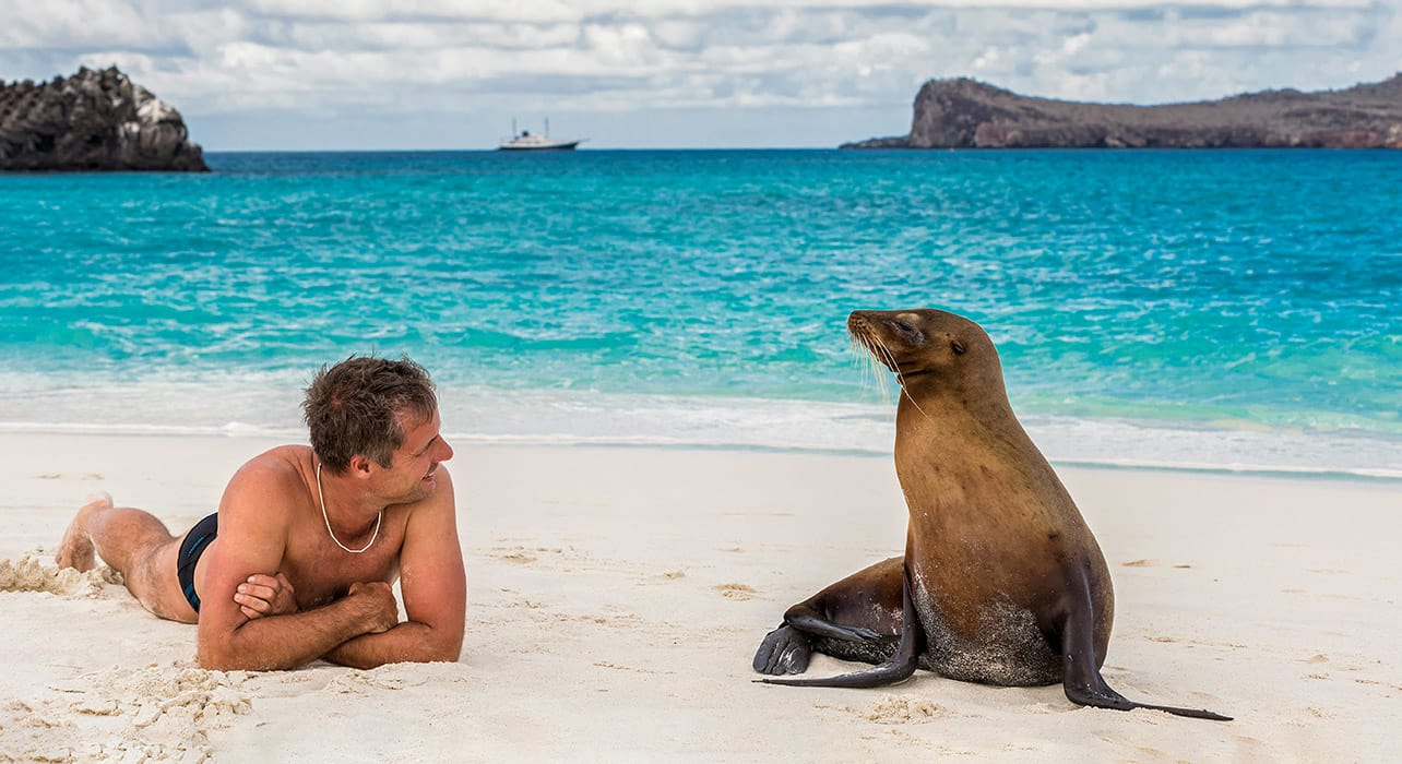 galapagos man with sea lion